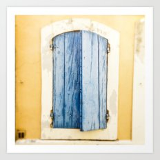 Blue wooden shutter in yellow wall. Art Print