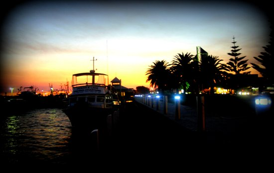 Night lights as Dusk settles over the Esplanade in Lakes Entrance - Australia Art Print