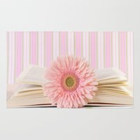 Pink flower on book (Retro Still Life Photography)  Rug