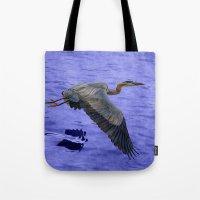 Great blue heron in fly Tote Bag