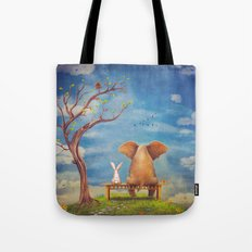 Elephant and rabbit sit on a bench on the glade Tote Bag