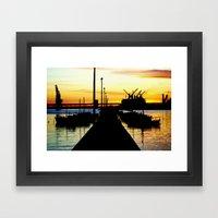 Light shines over the Harbour Framed Art Print