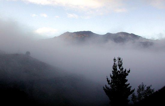 Fog covering Cradle Top Mountain  Art Print