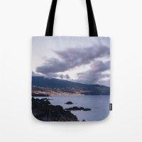 Volcanic coastline and lights of Santa Cruz at twilight. La Palma, Canary Islands. Tote Bag