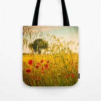 Poppies with tree in the distance Tote Bag
