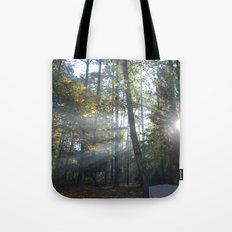 Sun Peaking through Woods. Tote Bag