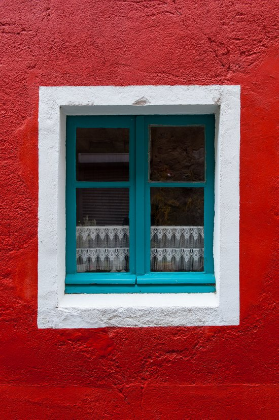 The blue window and the red wall Canvas Print