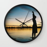 Female Body in the Amazon River Wall Clock