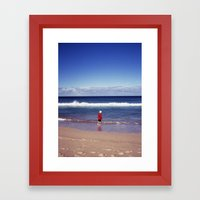 Red jacket and blue ocean Framed Art Print