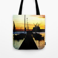 Light shines over the Harbour Tote Bag