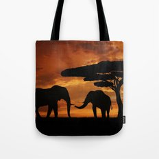 African elephants silhouettes in sunset Tote Bag
