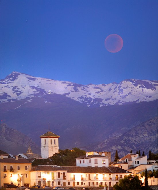 total lunar eclipse over the city of Granada and the Alhambra Art Print