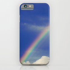Rainbow over fluffy white clouds in the blue sky iPhone 6 Slim Case