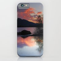 iPhone & iPod Case featuring Trees in the water at the red sunset by Guido Montañés