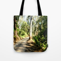 Along a forest Road Tote Bag