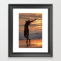Dancing in the Surf at Sunset Framed Art Print