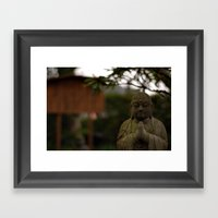praying buddah Framed Art Print