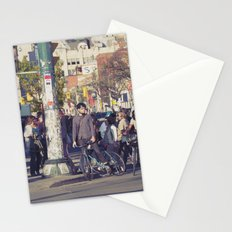 man in helmet stares wistfully across a busy intersection... Stationery Cards
