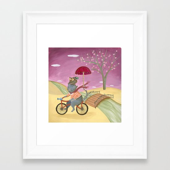 Riding the bike. Framed Art Print