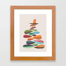 Bird nesting on top of pebbles hill Framed Art Print