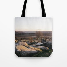 Owler Tor rock formations at sunset. Derbyshire, UK. Tote Bag