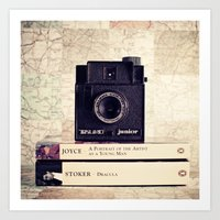 Vintage black camera and Joyce and Dracula books on Map pattern background  Art Print
