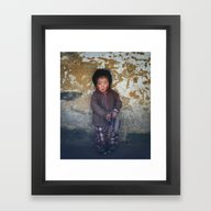 Framed Art Print featuring Portrait Of Serious Youn… by Marozn