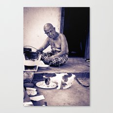 Wat man and his cat Canvas Print