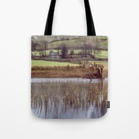 Farm and snow covered mountain reflections in Brothers Water. Cumbria, UK. (Shot on film). Tote Bag