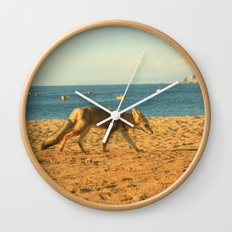 Fox on the beach Wall Clock