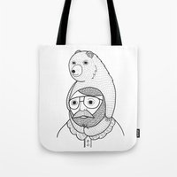 Tote Bag featuring On how baby bears are often used as winter hats by Michael C. Hsiung