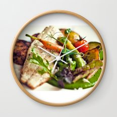 Branzino filet, chorizo dumplings, baby vegetables and spinach sauce Wall Clock