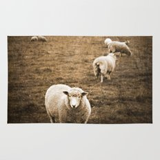 Sheep in a field Rug