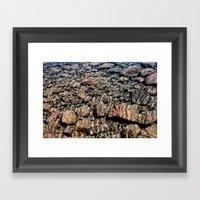 rocks in water Framed Art Print