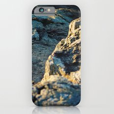 The sun is setting over the rocks iPhone 6 Slim Case