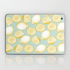 Lemons On Turquoise Background Laptop & iPad Skin