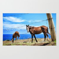 Horses against a blue sky Rug