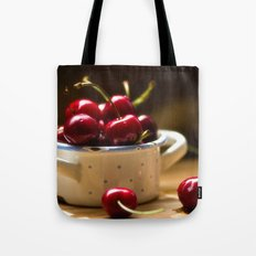 Red Cherries on the table Tote Bag