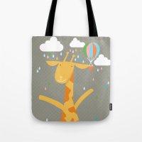 giraffe in the rain Tote Bag