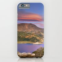 iPhone Cases featuring Lenticular clouds at the red sunset by Guido Montañés
