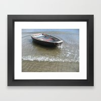 Wooden boat in the surf Framed Art Print
