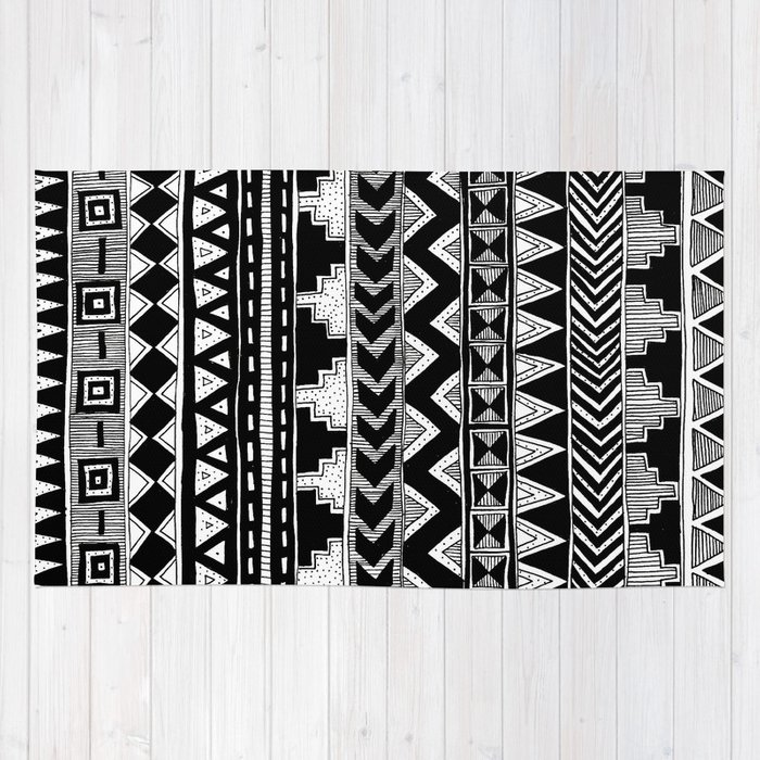 busy black and white aztec pattern rug by stacey muir society6