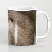 The curious otters Mug