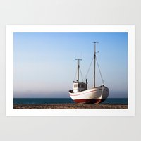 Fishing boat pulled up on beach Art Print