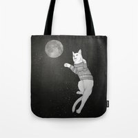 Cat trying to catch the Moon Tote Bag