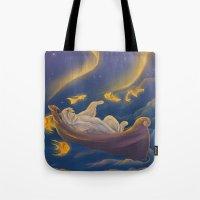 Golden fish and sailing polar bear  Tote Bag