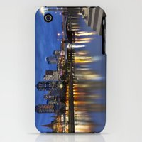 iPhone Cases featuring Skyline of Melbourne, Australia across the Yarra River at night by Sara Winter