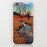 iPhone Cases featuring A stream, dry grass, reflections and trees | waterscape photography by Patrick Jobst