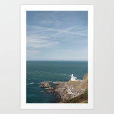 Lighthouse at Hartland Quay with Lundy Island beyond. Devon, UK. Art Print