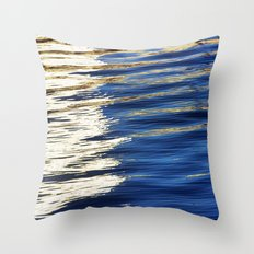 golden light streaks on water Throw Pillow
